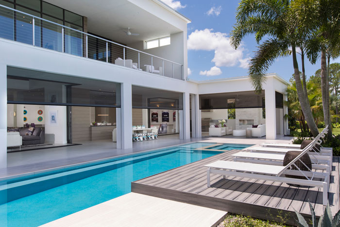 """Winter Park architect and builder Phil Kean says outdoor living areas can """"serve as another room in your home."""" And he demonstrates it with such features as a pool area with a lanai and a summer kitchen protected by a retractable screen."""